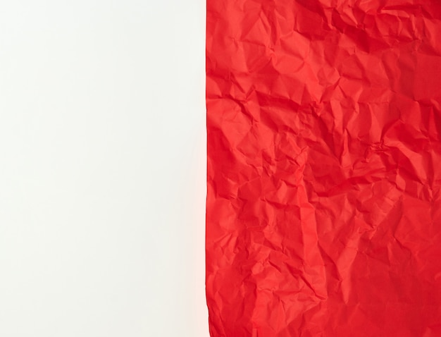Crumpled red  paper on a white background Premium Photo