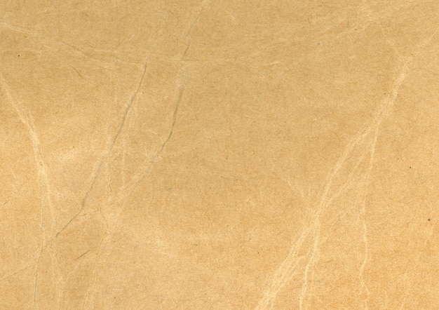 Crumpled sepia paperboard Free Photo