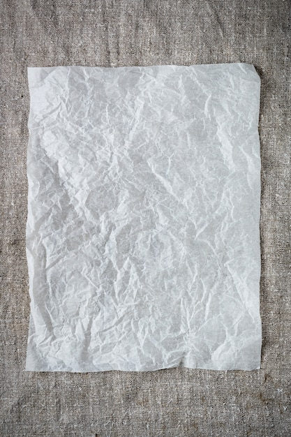 Crumpled sheet of paper on a gray background. Premium Photo