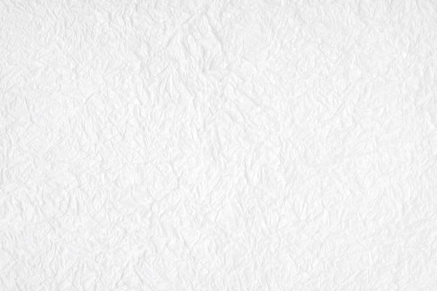 Latar belakang bertekstur kertas murbei putih kusut, detail ditutup Foto Premium