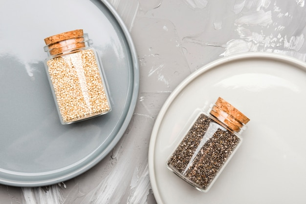 Crushed seeds in tiny glass jars organic food Free Photo