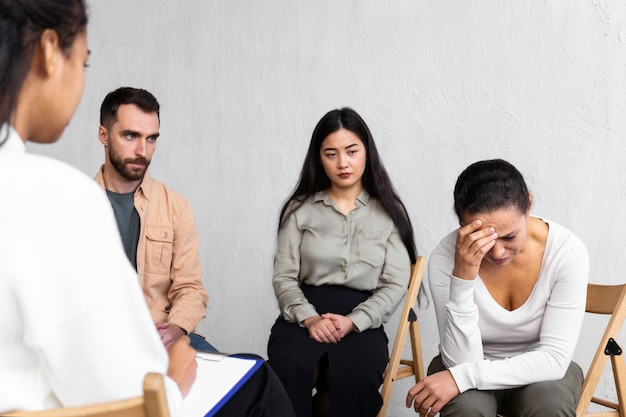 Crying woman at a group therapy session Premium Photo