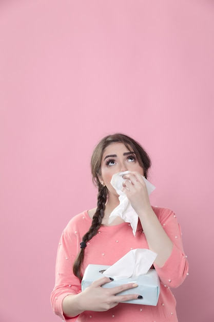 Crying woman using napkins and looking up Free Photo