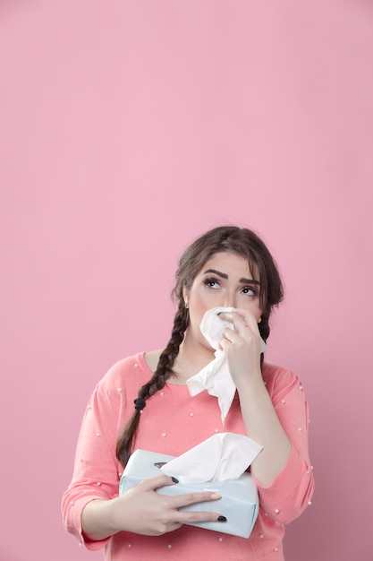 Crying woman using napkins Free Photo