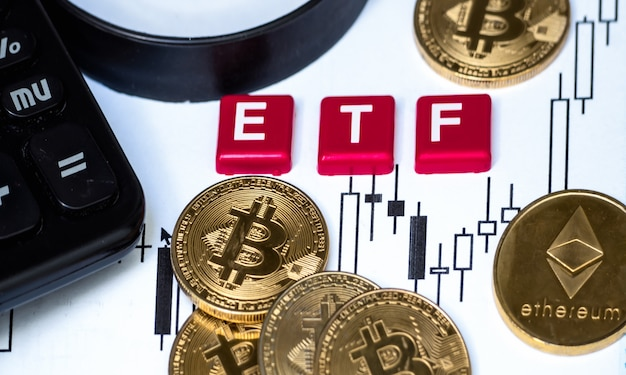 Crypto currency  bitcoin coin with etf text and magnifying glass placed on paper with a candlestick chart Premium Photo