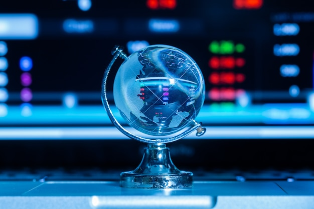 Crystal globe with stock information Free Photo