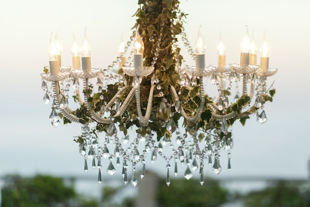 Crystals hang from the chandelier decorated with greenery photo crystals hang from the chandelier decorated with greenery free photo aloadofball Image collections