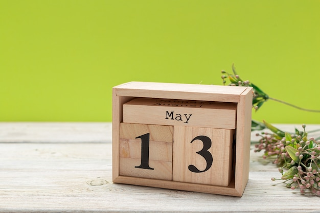Cube calendar for may 13th on wood Premium Photo