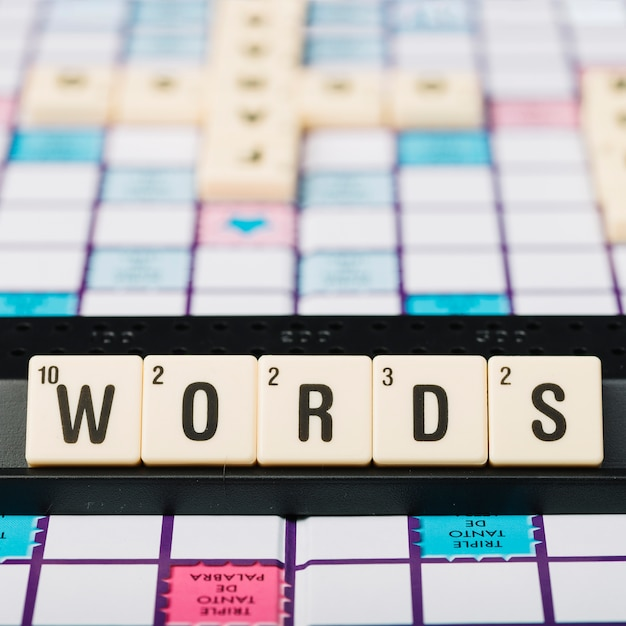 Cubes with word title on support Free Photo