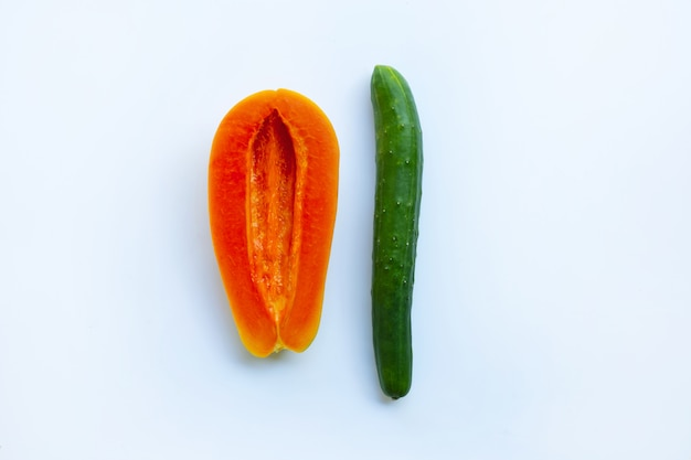 Cucumber and papaya  on white background. sex concept. Premium Photo