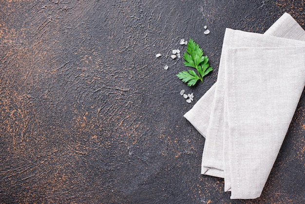 Culinary background with napkin and parsley Premium Photo
