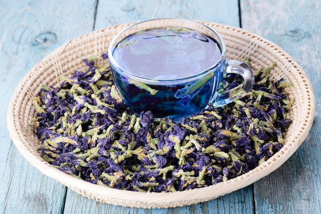 Cup of butterfly pea tea with blue dry flowers for healthy drinking Premium Photo