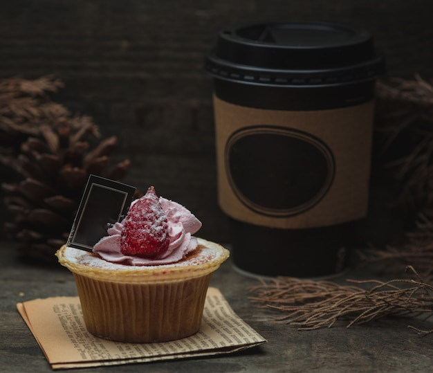 Cup cake with raspberry and chocolate. Free Photo