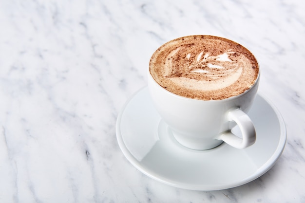 Cup of cappuccino on the table Premium Photo