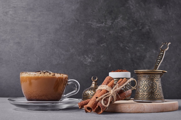 A cup of cappuccino with cinnamon. Free Photo