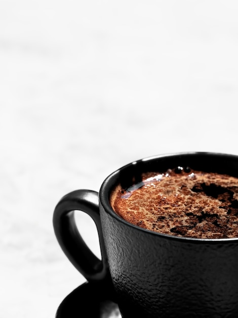 Cup of coffee of aromatic espresso on a light gray surface Free Photo