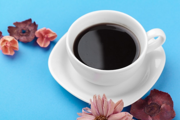 Cup of coffee on a blue table Premium Photo