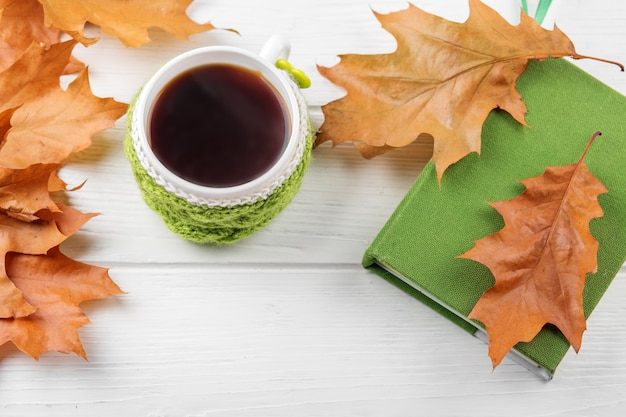A cup of coffee and a book. the concept of autumn, still life, relaxation, study Premium Photo