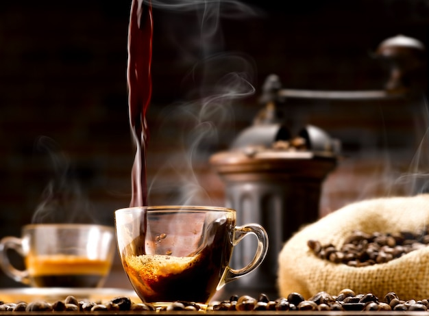 Cup of coffee and coffee beans Premium Photo