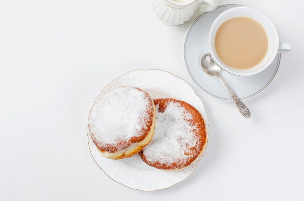 Cup of coffee and a donuts with jam for breakfast Premium Photo