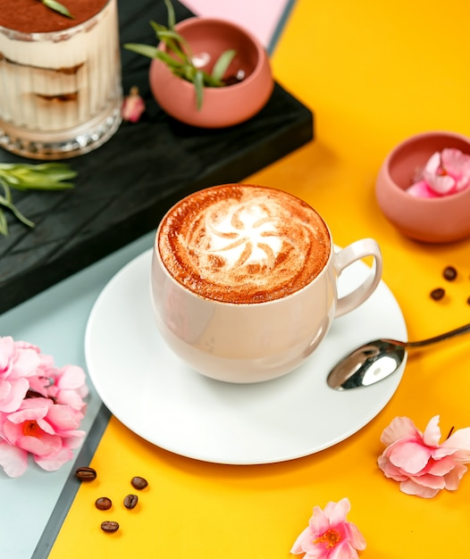Cup of coffee drink with latte art and sugar sprinkles Free Photo