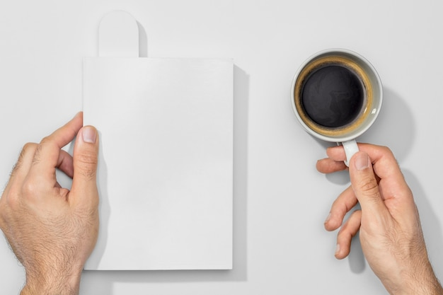 Cup of coffee and empty books Premium Photo