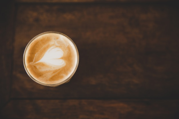 Cup of coffee latte on wood table in coffee shop cafe Free Photo