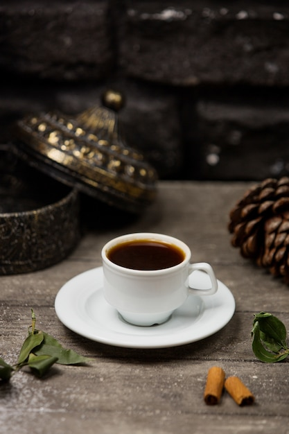 A cup of coffee placed on wooden table Free Photo