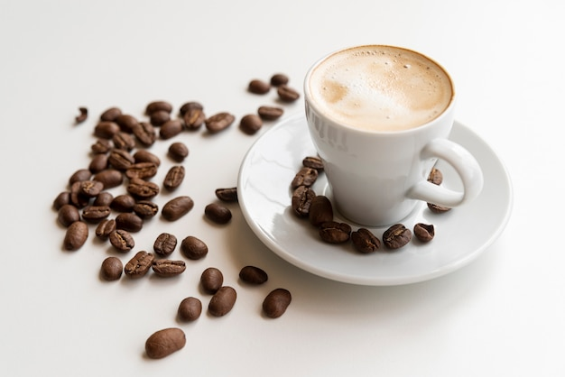 Cup of coffee with coffee beans Free Photo