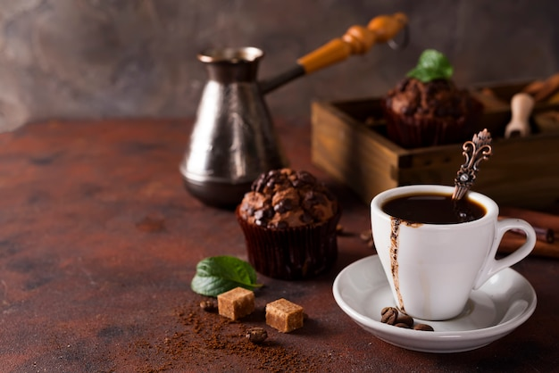Cup of coffee with cooffee beans, wooden box with grains of coffee and spices Premium Photo
