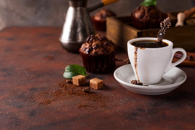 Cup of coffee with cooffee beans, wooden box with grains of coffee and spices, Premium Photo