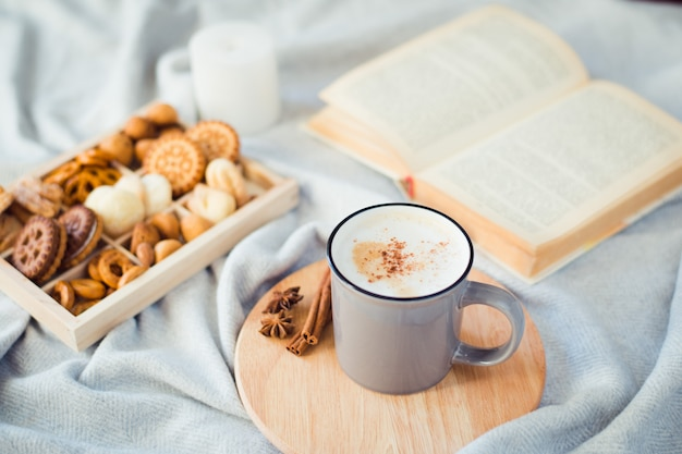 Cup of coffee with cookies and book, autumn still life Premium Photo