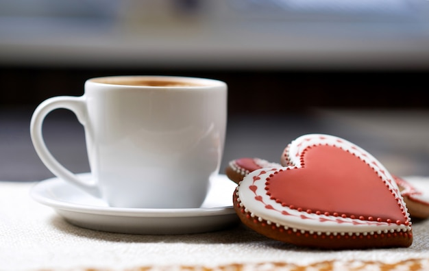 Cup of coffee with cookies Free Photo