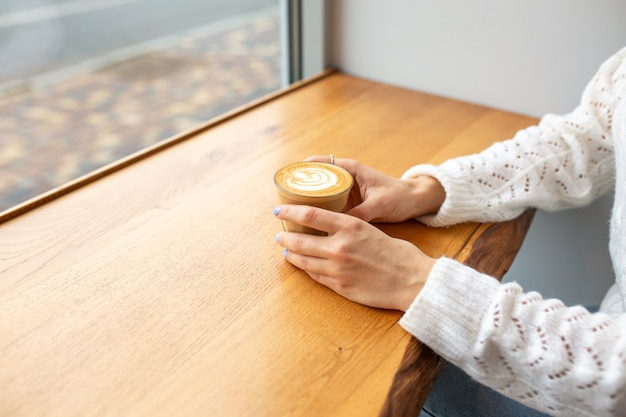 A cup of coffee with cream. hot drink. latte in a glass. time for yourself. delicious coffee in a romantic setting. morning concept. breakfast Premium Photo