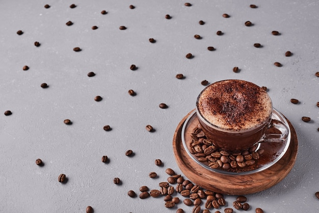 A cup of coffee with foam on the top. Free Photo
