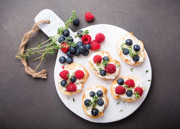 Cup of coffee with fruit sandwiches Premium Photo