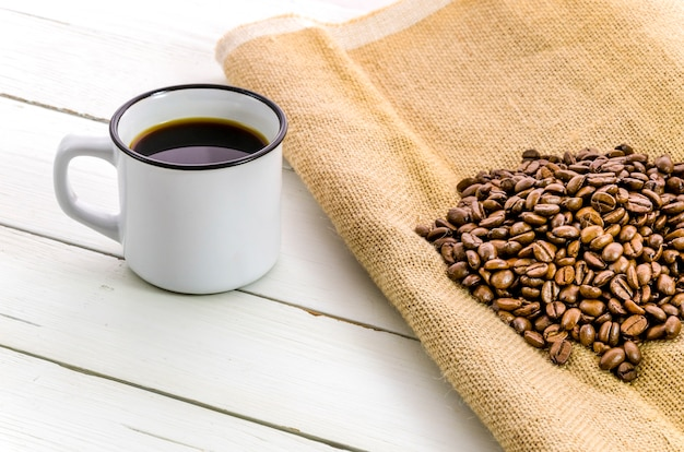 Cup of coffee with grains Free Photo