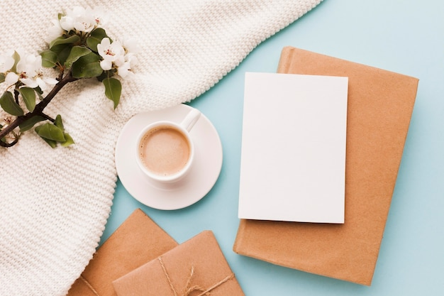 Cup of coffee with greeting card and gift Free Photo