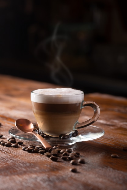 Cup of coffee with milk. hot latte or cappuccino prepared with milk Premium Photo