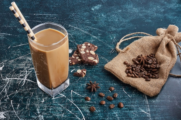 A cup of coffee with snacks. Free Photo