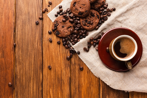 Cup of coffee with tasty cookies Free Photo
