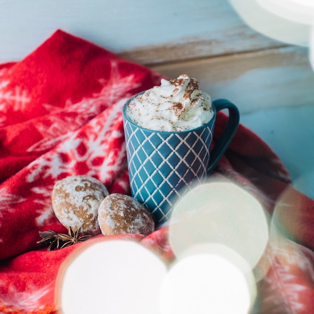 Cup of coffee with whipped cream and gingerbread Free Photo