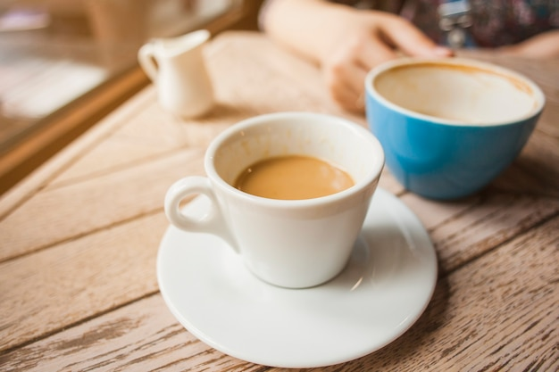 Cup of coffee on wooden table in cafeteria Free Photo