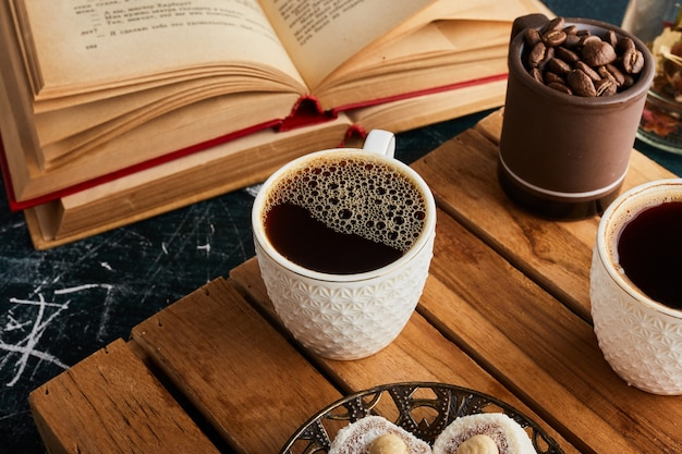 A cup of coffee on wooden tray. Free Photo