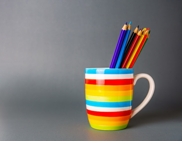 A cup colorful with group pencil all color in gray Premium Photo