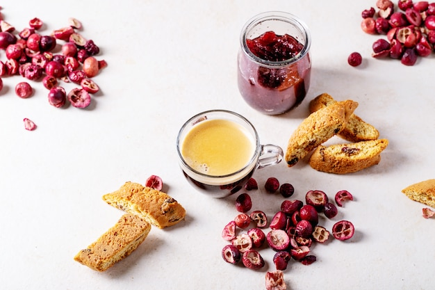 Cup of espresso coffee with cranberry cantucci Premium Photo