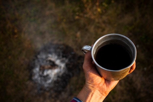 Cup of fresh coffee prepared while camping Free Photo