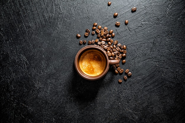 Cup of fresh made coffee served in cup Free Photo