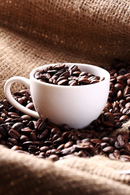 Cup full of coffee beans Free Photo