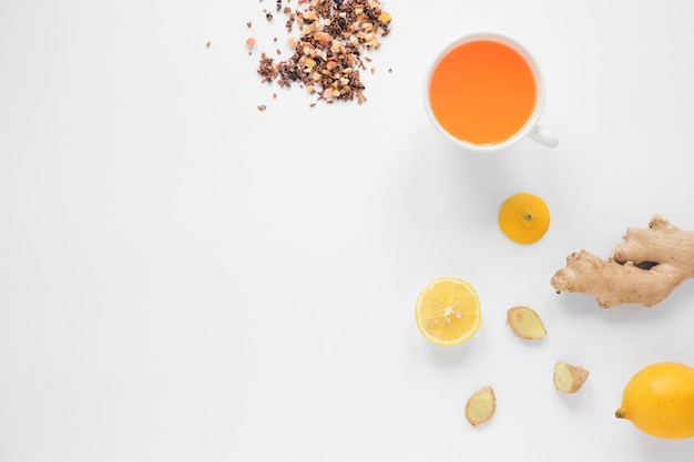 Cup of ginger tea; lemon; herbs and honey on white background Free Photo